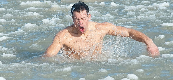 man bursting out of icy water
