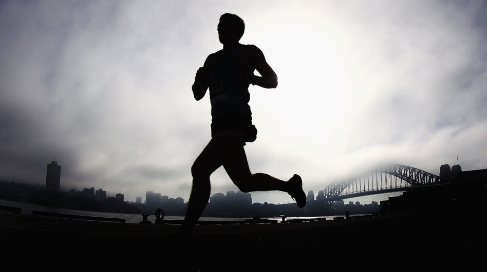 silhouette of a man runs